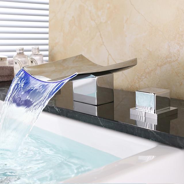 messinki kylpyhuoneen pesuallashana, led-vesiputous laajalle levinnyt kromi kannelle asennettu kaksi kahvaa kolme reikää kylpyhanat kuumalla ja kylmällä kytkimellä