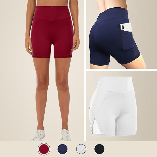 กางเกงกีฬาขาสั้นเอวกว้างสำหรับผู้หญิงพร้อมกระเป๋าโทรศัพท์สีทึบเอวสูงยืดหยุ่นกางเกงโยคะวิ่งด้านล่าง
